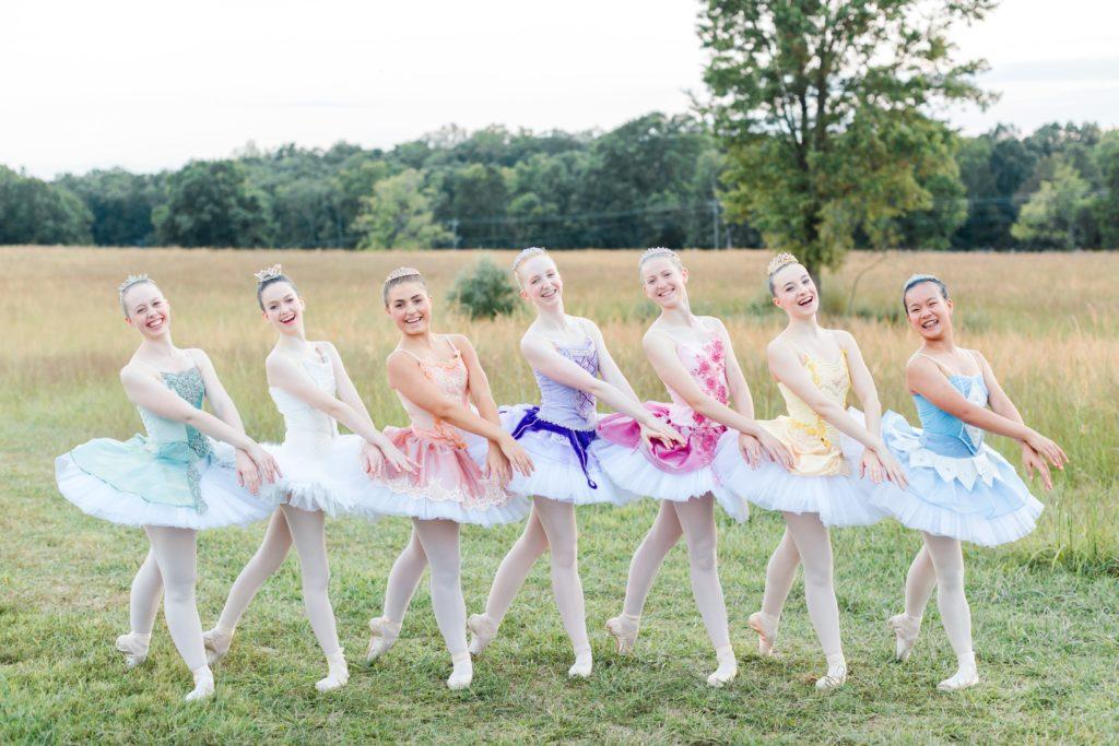 6 dancers in rainbow color order tutus
